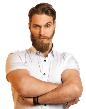 Handsome young bearded man in process of trimming his beard isolated on a white background