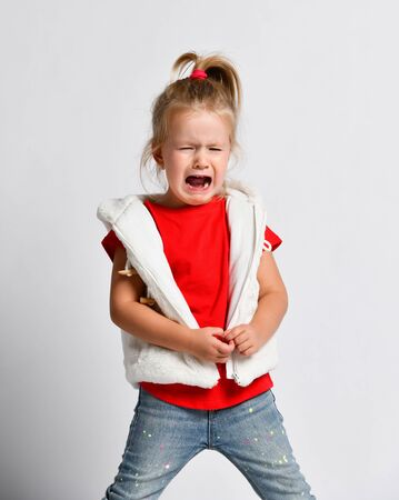 Weeping bitterly, crying, yelling loud, abused helpless kid girl in red t-shirt has got lost.