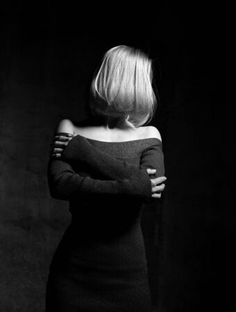 Sensual blonde beautiful woman mysteriously thinking. Black and white image close up portrait composition Standard-Bild