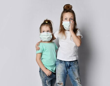Two children are afraid of the disease virus wear protection masks from the Coronavirus Covid-19 afraid madness pandemic panic epidemic spreads across the globe on white background