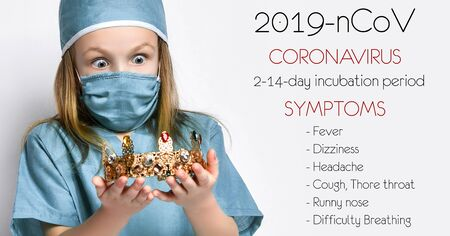 Little girl child kid in medical coat and protection mask from the Coronavirus Covid-19 hold gold crown corona symbol of madness pandemic panic epidemic spreads across the globe