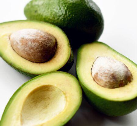 Fresh avocado slices on white background closeup