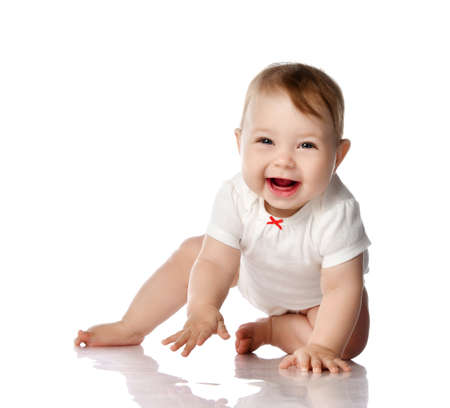 Seven month Infant child baby toddler sitting and happy looking laughing at the corner with text space isolated on a white background