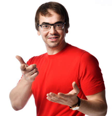 Portrait of positive smiling sociable person unshaved man in glasses and red t-shirt telling vivid stories gesturing asking over white background. Expressing emotions and moods concept