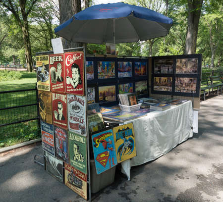 Souvenirs and vintage posters sale tray in the Central Park of New York