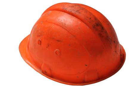 Dirty orange construction helmet isolated on white backround Stock Photo - 9358907