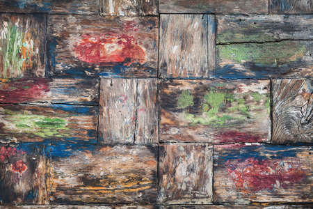 teakwood: Vintage style, painted in various colors, old damaged teakwood table board with rough surface of wood texture, cracks, grain. Natural material backgrounds and teak furniture manufacturing in Indonesia Stock Photo