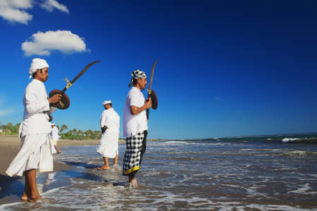 buckler: BALI INDONESIA  MARCH 18: Portrait of unidentified men with traditional ceremonial swords before ritual fighting dance during Melasti  religious ceremony of Balinese people Bali on 18 March 2015