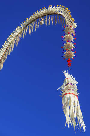asian culture: Penjor  house temple traditional  Balinese symbol and decoration for Galungan hindu religious ceremony holidays art festivals. Asian culture tours backgrounds and details of tropical island Bali