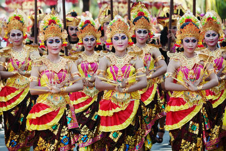 BALI INDONESIA  JUNE 13: Unidentified people with traditional makeup on their faces and dressed in colorful Balinese costumes on parade at Bali Art Festival 2015 in Denpasar Bali on 13 June 2015