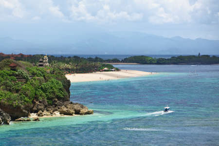 travel locations: Panoramic view of sea coast with clear water and luxury hotels and villas sand beaches on Nusa Dua - center of recreational tourism and popular destination for summer family vacation on Bali island
