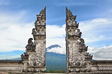 Entrance gate Pintu Bintar to traditional temple Lempuyang on Agung mount background - Bali island symbol. Culture and architecture of Asian people, Indonesian and Balinese landscapes and wallpapers