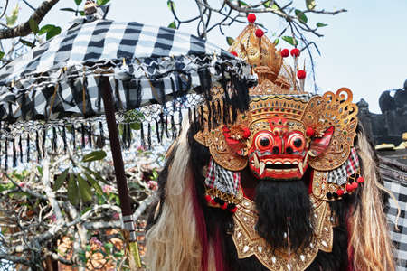 bali: Traditional Balinese Barong - creature with a lion s body - the symbol of the protective spirit of Bali island. Arts, religion and culture festivals of Indonesian people. Asian travel backgrounds. Stock Photo