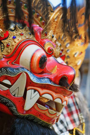 travel backgrounds: Barong - protective spirit and Bali island symbol, is featured in tourist attraction - traditional Balinese dance. Arts, religion and culture festivals of Indonesian people. Asian travel backgrounds.