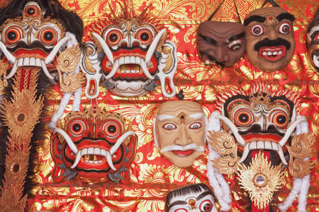 travel backgrounds: Traditional balinese masks for folk show Topeng, canonical masks of Rangda spirit for ritual temple dances. Arts, religion of Bali and culture festivals of Indonesian people. Asian travel backgrounds.