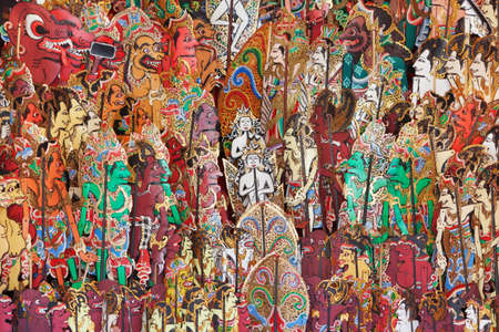 asian culture: Traditional characters of balinese and javanese folk shadow puppets show - wayang kulit. Arts, indigenous crafts on Bali island and culture festivals of Indonesian people. Asian travel backgrounds. Stock Photo