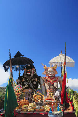 silence: Barong Landung traditional protective spirit of Bali in human body at ceremony Melasti before Balinese New Year and silence day Nyepi. Holidays, festivals, rituals, art, culture of Indonesian people.
