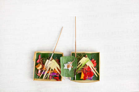 Canang sari traditional offering for spirits of Bali island at ceremony Melasti before Balinese New Year and silence day Nyepi. Holidays, festivals, rituals, culture, art objects, of Indonesian people