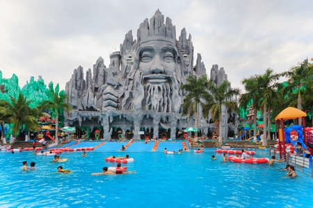 Ho Chi Minh city ( Saigon ), Vietnam - September 02, 2015: People in outdoor swimming pool in children water park and historical theme amusement park Suoi Tien - popular travel destination in Vietnam.