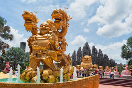 Ho Chi Minh city ( Saigon ), Vietnam - September 02, 2015: Fountain with gold dragon and buddha statues in water park and historical theme amusement park Suoi Tien - best south Vietnam cultural park.