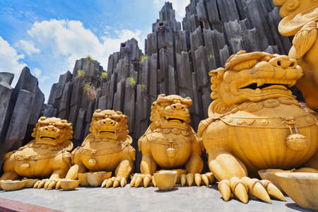 Ho Chi Minh city ( Saigon ), Vietnam - September 02, 2015: gold dragons statues in children water park and historical theme amusement park Suoi Tien - popular travel destination in south Vietnam . Editorial