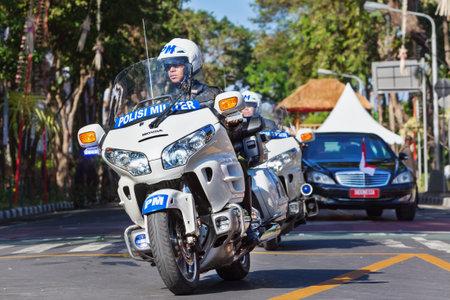 DENPASAR, BALI ISLAND, INDONESIA - JUNE 11, 2016: President Indonesia Joko Widodo ( Jokowi ) motorcade with military police motorbike escort at Denpasar streets during official visit to Bali