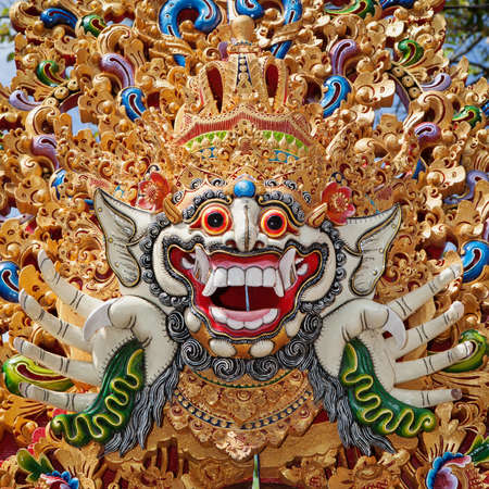 asia people: Traditional Barong mask pattern in temple - protective spirit, Bali island symbol. Featured in Balinese dances and ceremonies. Culture, religion, Arts festivals of Indonesian people. Travel background Stock Photo