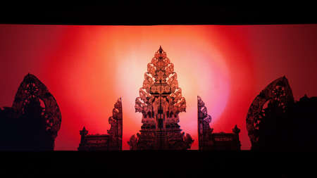 Black shadow silhouette of traditional Bali Island temple. Balinese puppets Wayang Kulit. Culture, religion, art festivals of Indonesian people. Travel background