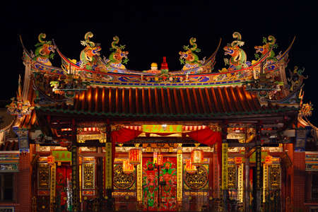 Decorated roof and second floor of traditional old chinese temple Seh Tek Tong Cheah Kongsi in Georgetown, Penang, Malaysia. UNESCO world heritage site. Night view.