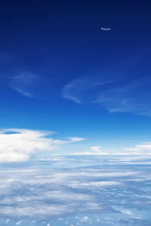 Oncoming flight traffic in mid air. Aircraft flying above earth, beautiful white cloud. Clear blue sky, aerial view from cabin through plane window. Vacation tour, travel background with copy space