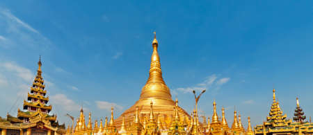 View of famous Myanmar temple and popular place to visit at Yangon city tour - pagoda Shwedagon with Buddha relics. Famous travel destination in Asia. Traditional Burmese art and culture background. Stock Photo