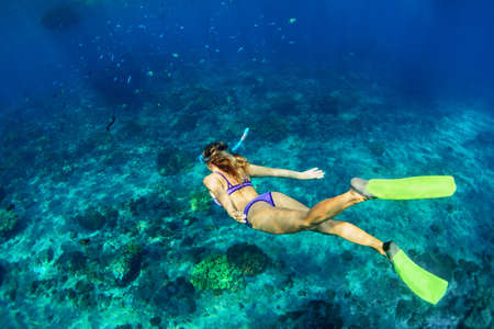 Happy family - girl in snorkeling mask dive underwater with tropical fishes in coral reef sea pool. Travel lifestyle, water sport outdoor adventure, swimming lessons on summer beach holiday with kids Reklamní fotografie - 82808717