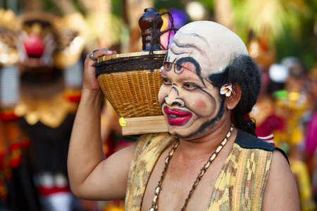 DENPASAR, BALI ISLAND, INDONESIA - JUNE 11, 2016: Face portrait of traditional Balinese comedian Bondres on street parade at art and culture festival of Indonesian people. Editorial