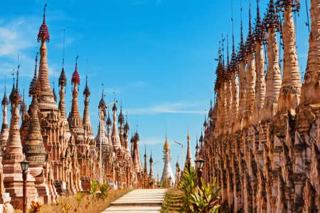 Ancient buddhist Kakku Pagodas - place of annual Pay Pwe festival, popular travel destination near Inle lake in Myanmar. Traditional arts, culture and religion of Burmese people. Travel background.