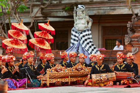 BALI, INDONESIA - June 20, 2015: Musicians of Gamelan orchestra in Balinese people costume playing ethnic ritual music on traditional Indonesian instruments. Editorial