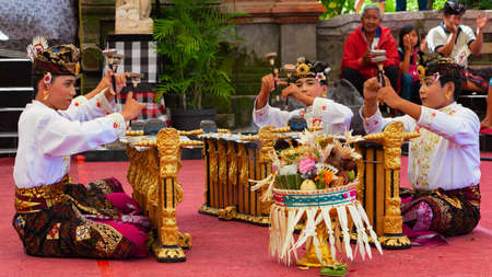 BALI, INDONESIA - June 21, 2015: Musicians of Gamelan orchestra in Balinese people costume playing ethnic ritual music on traditional Indonesian instruments.