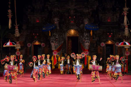 Bali, Indonesia - June 28, 2015: Musicians of Baleganjur orchestra in Balinese people ethnic costumes dancing and playing ritual music on traditional Indonesian instruments - Ceng-ceng, kendang, gong.