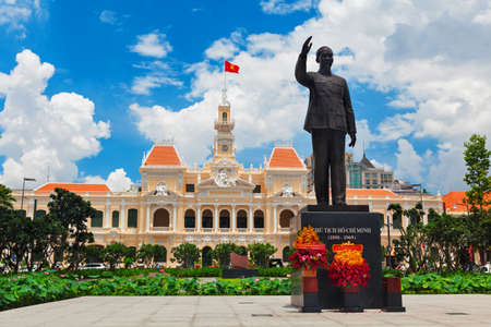 Ho Chi Minh statue in front of City Hall, is known as Ho Chi Minh City Peoples Committee Head office Saigon. Popular place to visit in Saigon at day tour. Travel destinations in Vietnam
