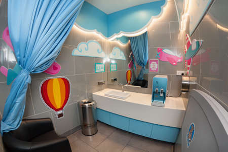 Kuala Lumpur, Malaysia - August 30, 2015: Baby care room equipped for changing diapers and feeding infants. Service facilities for parents and families traveling with little children in KLIA 2 airport Editöryel