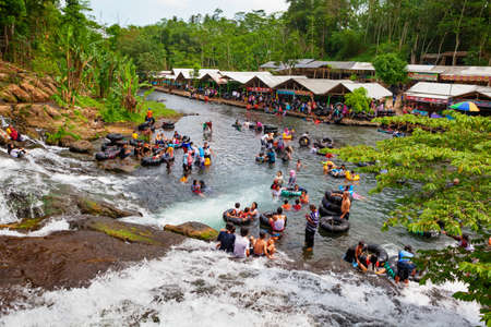 East Java, Indonesia - July 11, 2018: Sumber Maron - natural spring water spa with waterfall and swimming pools. Popular place to visit for family holidays day tour. Travel destination in Malang Editorial