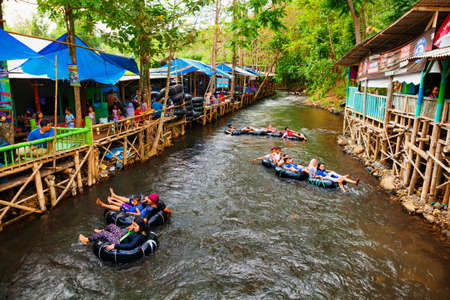 East Java, Indonesia - July 11, 2018: Sumber Maron - natural spring water spa with funny rafting on inflatable rings. Popular place to visit for family holidays day tour. Travel destination in Malang