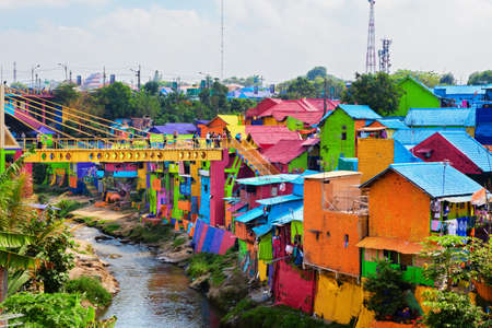 Malang, Indonesia - July 12, 2018: Jodipan village with painted colorful houses ( Kampung Warna Warni ) Popular place to visit for city walking tour on family holidays. Travel destination in East Java