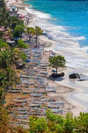 Aerial view of Pantai pasir putih ( White sand beach ) - beautiful beach hidden in tropical jungle. Popular travel destination of Bali island day tour. Best beach for family summer vacation with kids. Stock Photo