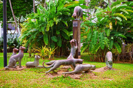 Kuching, Malaysia - March 13, 2019: Group of funny cats metal statue at Sarawak river waterfront park. Cat is a symbol of Kuching city on Borneo island