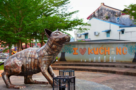 Kuching, Malaysia - March 13, 2019: Funny metal cat statue at waterfront of Sarawak river. Cat is a symbol of Kuching city Editorial