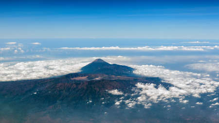 Aerial photo of Bromo Tengger Semeru National Park with highest peak of Java island Mount Semeru. Volcano Bromo is popular place for tourist adventure tours. Popular travel destinations in Indonesia.
