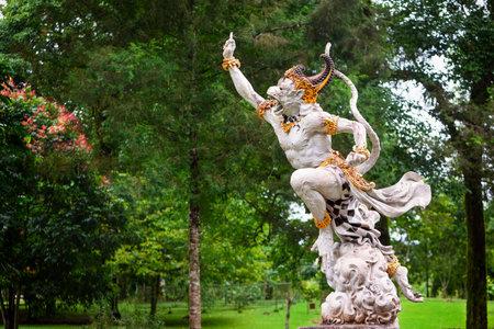 Ancient statue of fighting Hanuman from epic Hindu legend Ramayana in Bedugul botanical garden. Traditional arts, culture of Bali, popular travel destination in Indonesia
