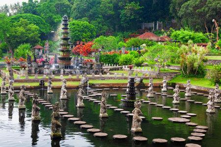 Ancient statue of fighting Kumbakarna Rakshasa from epic Hindu legend Ramayana in Bedugul botanical garden. Traditional arts, culture of Bali, popular travel destination in Indonesia Редакционное