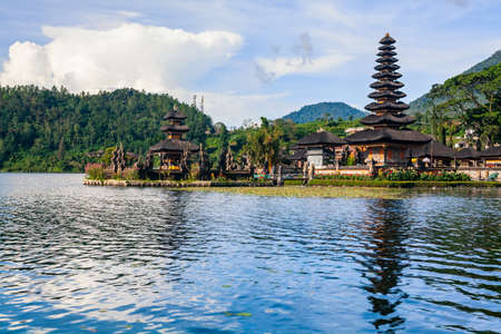 Scenic view during boat water walk at Beratan lake in Bedugul. Ancient Pura Ulun Danu Bratan - traditional Balinese hindu temple. Popular travel destinations, art, culture of Bali island, Indonesia.