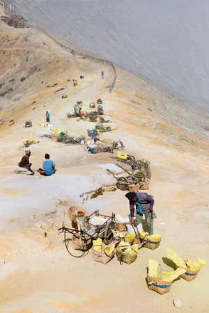 Java island, Indonesia - September 16, 2019: Baskets with natural sulfur carried from crater mine in miners rest camp. Extensive manual labour at sulphur mining operation in Kawah Ijen volcano